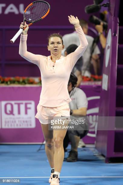 Simona Halep of Romania gestures after defeating Anastasija Sevastova of Latvia in the round of 16 during the Qatar Open tennis competition in Doha...