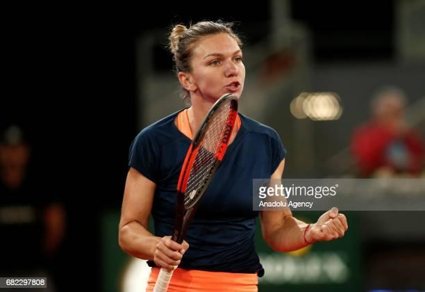 Simona Halep of Romania gestures during the Mutua Madrid Open semi final tennis match between Simona Halep of Romania and Anastasija Sevastova of...