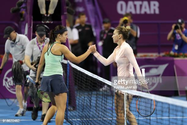 Simona Halep of Romania greats Anastasija Sevastova of Latvia after their match in the round of 16 during the Qatar Open tennis competition in Doha...
