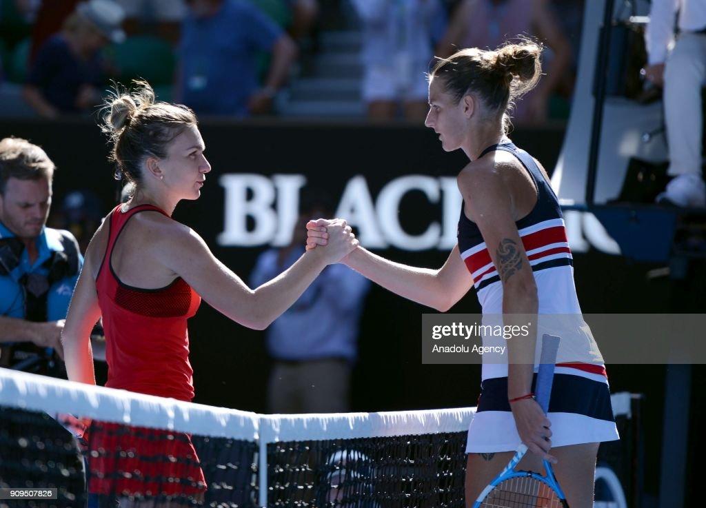 Simona Halep (L) of Romania greets Karolina Pliskova (R) of Czech Republic during the 2018 Australia Open tennis match at Melbourne Park in Melbourne, Australia on January 24, 2018.