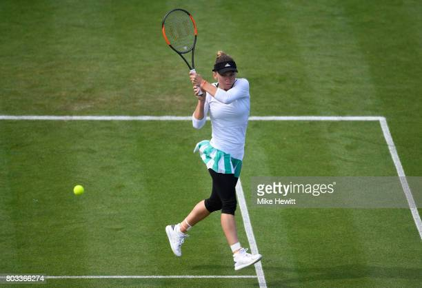 Simona Halep of Romania hits a backhand during the ladies singles quarter final match against Caroline Wozniacki of Denmark on day five of the Aegon...