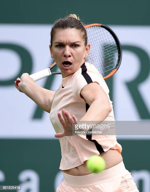 Simona Halep of Romania hits a forehand against Qiang Wang of China during Day 9 of BNP Paribas Open on March 13 2018 in Indian Wells California