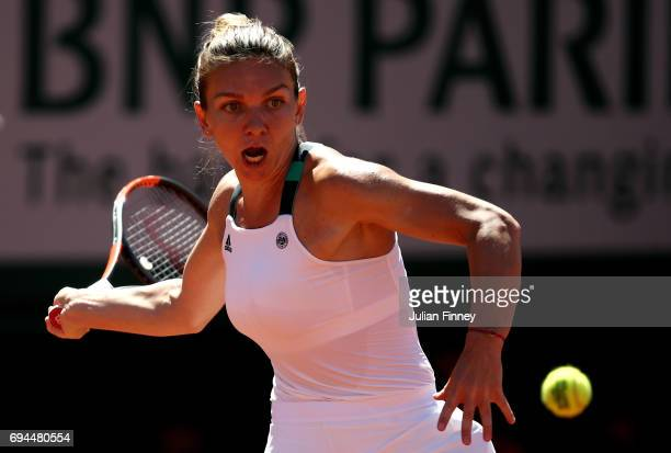 Simona Halep of Romania hits a forehand during the ladies singles final against Jelena Ostapenko of Latvia on day fourteen of the 2017 French Open at...