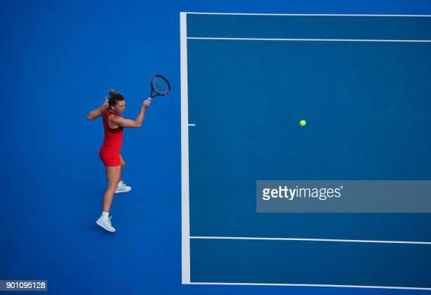 TOPSHOT Simona Halep of Romania hits a return against Aryna Sabalenka of Belarus during their women's singles quarterfinal match at the WTA Shenzhen...