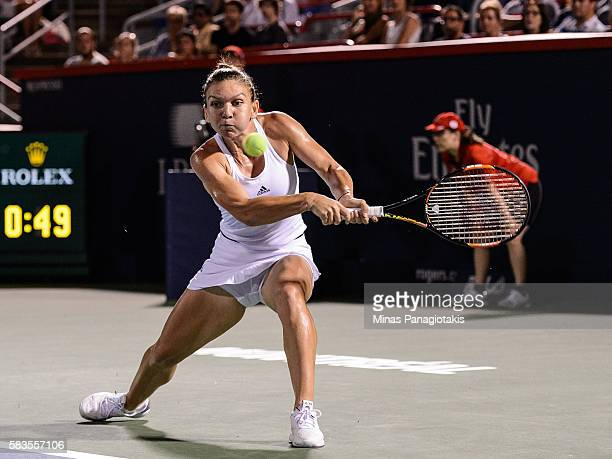 Simona Halep of Romania hits a return against Daria Gavrilova of Australia during day two of the Rogers Cup at Uniprix Stadium on July 26 2016 in...