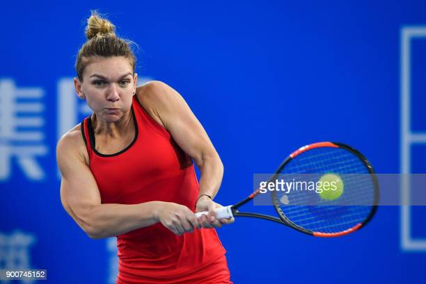Simona Halep of Romania hits a return against Duan Yingying of China during their women's singles second round match at the WTA Shenzhen Open tennis...