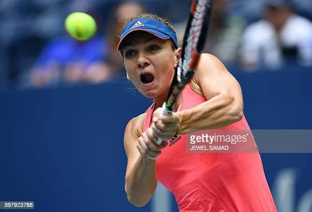 Simona Halep of Romania hits a return against Kirsent Flipkens of Belgium during their 2016 US Open Womens Singles match at the USTA Billie Jean King...