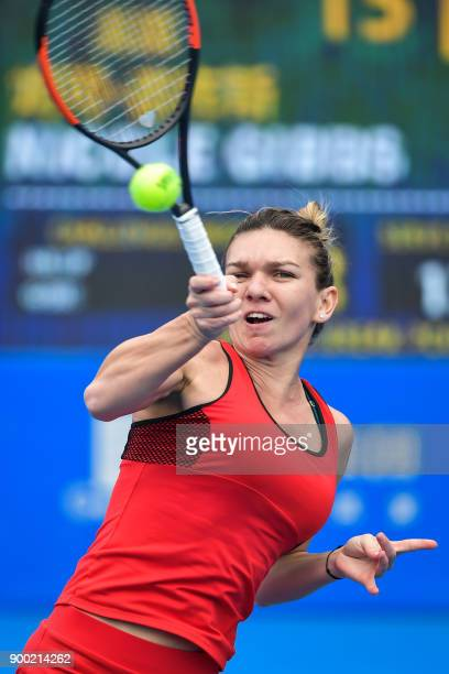 Simona Halep of Romania hits a return against Nicole Gibbs of the US in the first round of the Shenzhen Open tennis tournament in Shenzhen in China's...