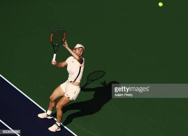 Simona Halep of Romania hits a shot during her match against Caroline Dolehide of the USA during the BNP Paribas Open at the Indian Wells Tennis...