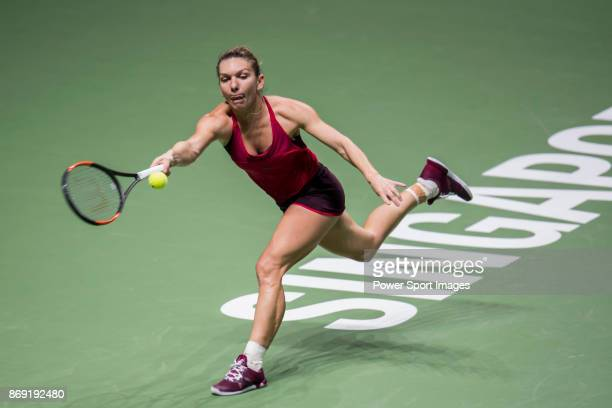 Simona Halep of Romania hits a shot in her singles match against Elina Svitolina of Ukraine during the BNP Paribas WTA Finals Singapore presented by...