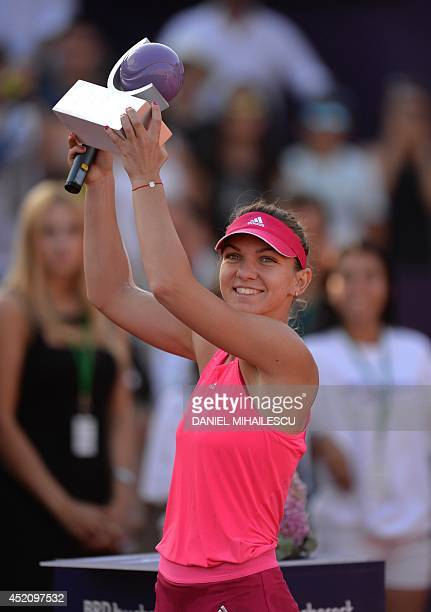 Simona Halep of Romania holds her trophy as she celebrates winning the single final at the WTA Bucharest tennis tournament in Bucharest on July 13...