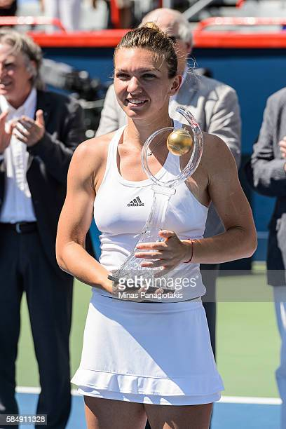 Simona Halep of Romania holds the trophy after defeating Madison Keys of the United States during day seven in final round action of the Rogers Cup...