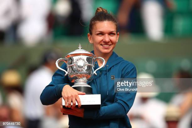 Simona Halep of Romania holds the trophy as she celebrates victory following the ladies singles final against Sloane Stephens of The United States...