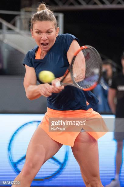 Simona Halep of Romania in action against Anastasija Sevastova of Latvia during day seven of the Mutua Madrid Open tennis at La Caja Magica on May 12...
