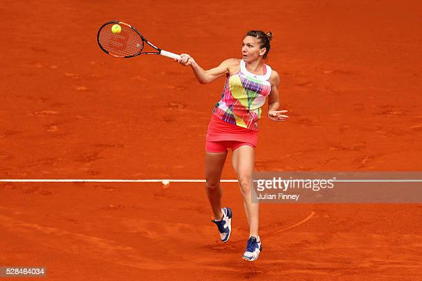 Simona Halep of Romania in action against IrinaCamelia Begu of Romania during day six of the Mutua Madrid Open tennis tournament at the Caja Magica...