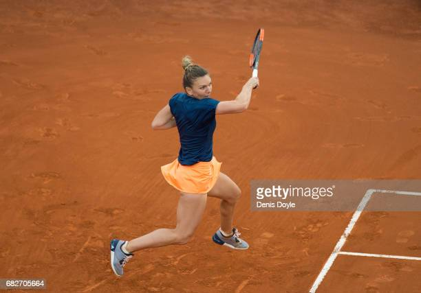 Simona Halep of Romania in action against Kristina Mladenovic of France in their final match during day eight of the Mutua Madrid Open tennis at La...