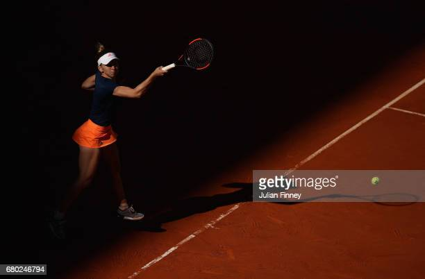 Simona Halep of Romania in action against Kristyna Pliskova of Czech Republic during day two of the Mutua Madrid Open tennis at La Caja Magica on May...