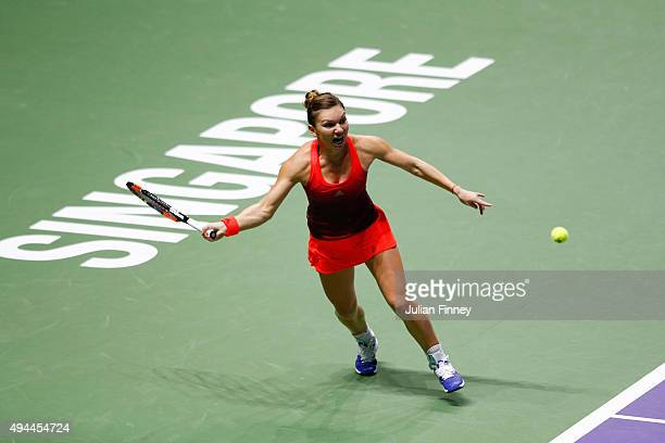 Simona Halep of Romania in action against Maria Sharapova of Russia in a round robin match during the BNP Paribas WTA Finals at Singapore Sports Hub...