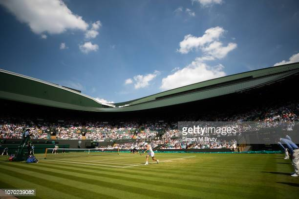 Simona Halep of Romania in action against Su-Wei Hsieh of Chinese Taipei on court one . During The Wimbledon Lawn Tennis Championship at the All...