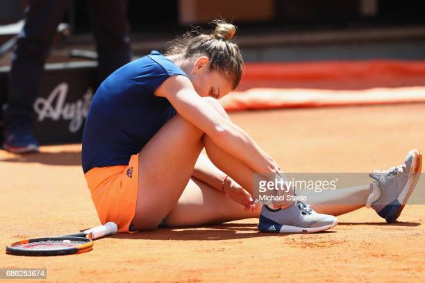 Simona Halep of Romania injures her ankle after slipping during the women's final against Elina Svitolina of Ukraine on Day Eight of the...