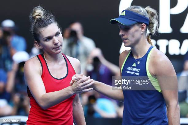Simona Halep of Romania is congratulated by Angelique Kerber of Germany after Halep won their semifinal match on day 11 of the 2018 Australian Open...