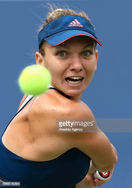 Simona Halep of Romania is in action against Carla Suarez Navarro of Spain during the Women's Singles match of the 2016 US Open at the Louis...