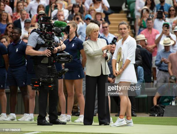 Simona Halep of Romania is interviewed by Sue Barker of the BBC after her victory over Serena Williams of USA in the Final of the Ladies Singles on...