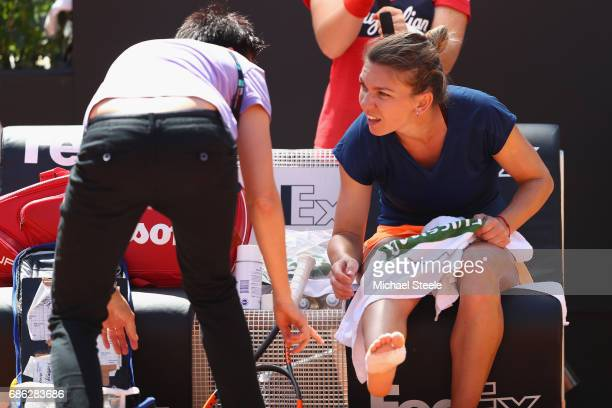 Simona Halep of Romania is treated by a medic after injuring her ankle during the women's final against Elina Svitolina of Ukraine on Day Eight of...