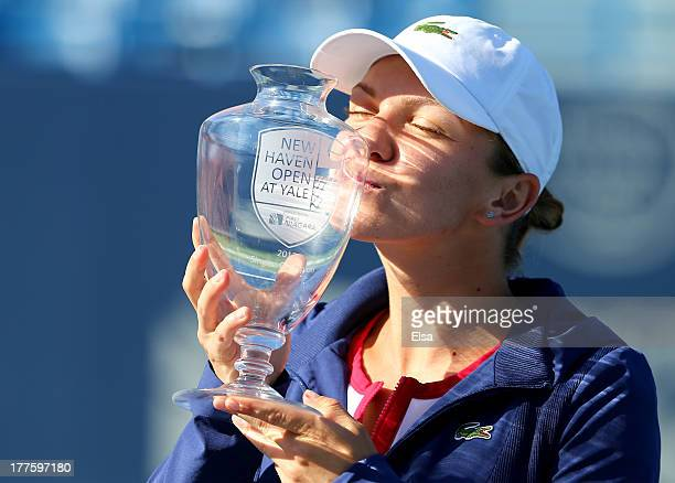 Simona Halep of Romania kisses the trophy after she defeated Petra Kvitova of the Czech Republic in the Women's Final on Day Seven of the New Haven...