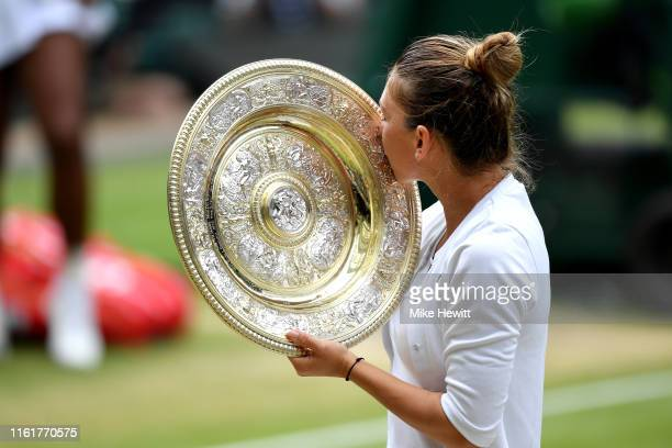 Simona Halep of Romania kisses the trophy after winning the Ladies' Singles final against Serena Williams of The United States during Day twelve of...