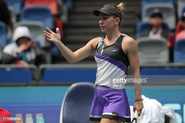 Simona halep of Romania leaves the court after retiring match against Elena Rybakina of Kazakhstan on Day 4 of 2019 Dongfeng Motor Wuhan Open at...