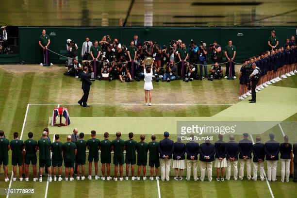 Simona Halep of Romania lifts the trophy after winning the Ladies' Singles final against Serena Williams of The United States during Day twelve of...