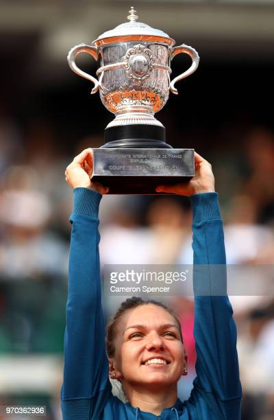 Simona Halep of Romania lifts the trophy as she celebrates victory following the ladies singles final against Sloane Stephens of The United States...