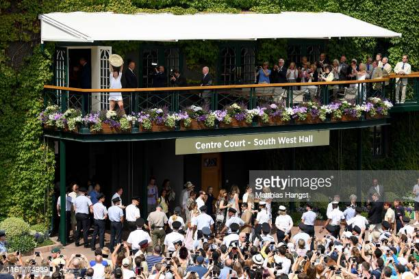 Simona Halep of Romania lifts the trophy on the balcony of Centre Court after winning the Ladies' Singles final against Serena Williams of The United...