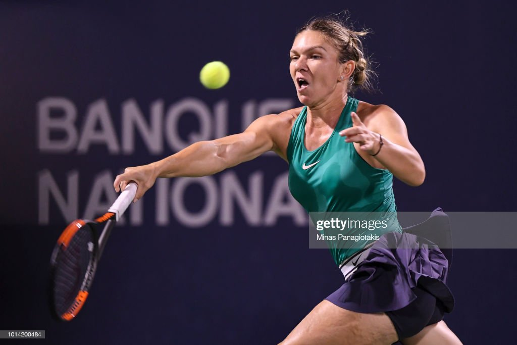 Simona Halep of Romania misses the ball against Venus Williams during day four of the Rogers Cup at IGA Stadium on August 9, 2018 in Montreal, Quebec, Canada.