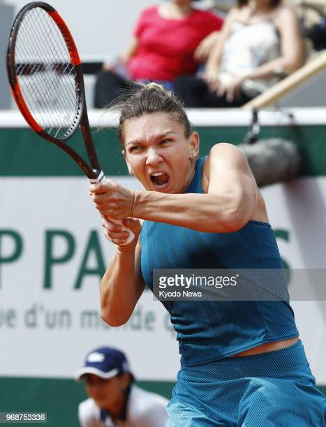 Simona Halep of Romania plays a backhand against Angelique Kerber of Germany in the quarterfinals of the French Open in Paris on June 6 2018 Halep...