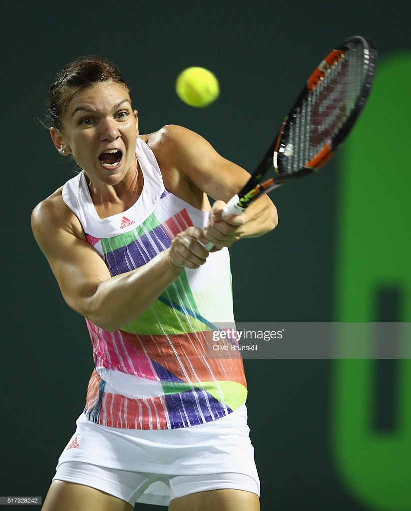 Simona Halep of Romania plays a backhand against Daria Kasatkina of Russia in their second round match during the Miami Open Presented by Itau at Crandon Park Tennis Center on March 24, 2016 in Key Biscayne, Florida.