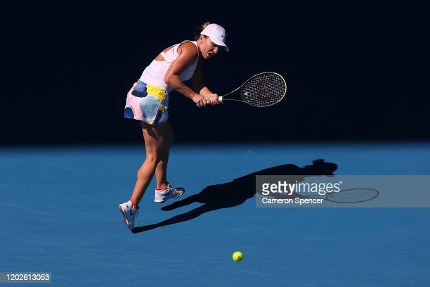 Simona Halep of Romania plays a backhand during her Women's Singles Quarterfinal match against Anett Kontaveit of Estonia on day ten of the 2020...