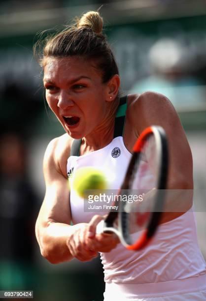 Simona Halep of Romania plays a backhand during ladies singles semifinal match against Karolina Pliskova of The Czech Republic on day twelve of the...