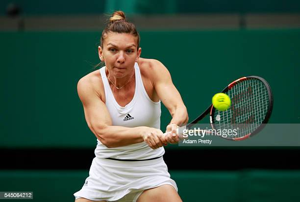 Simona Halep of Romania plays a backhand during the Ladies Singles Quarter Finals match against Angelique Kerber of Germany on day eight of the...