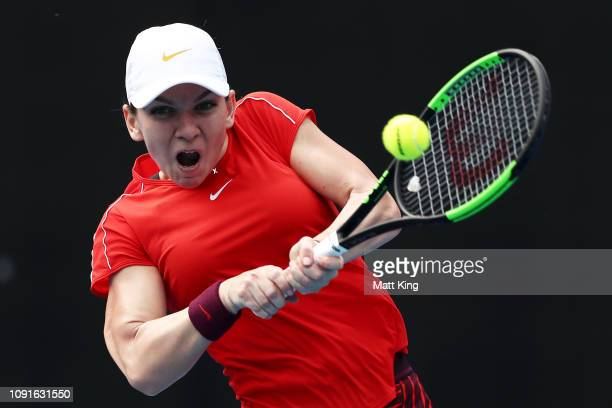 Simona Halep of Romania plays a backhand in her 2nd round match against Ashleigh Barty of Australia during day four of the 2019 Sydney International...