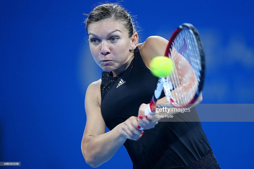 Simona Halep of Romania plays a backhand in her match against Barbora Zahlavova Strycova of the Czech Republic during day two of the China Open at the China National Tennis Center on September 28, 2014 in Beijing, China.