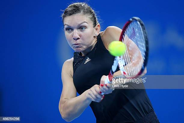 Simona Halep of Romania plays a backhand in her match against Barbora Zahlavova Strycova of the Czech Republic during day two of the China Open at...