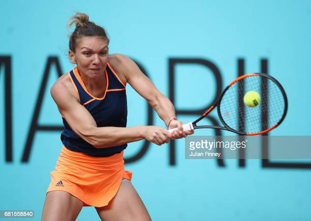 Simona Halep of Romania plays a backhand in her match against Samantha Stosur of Australia during day five of the Mutua Madrid Open tennis at La Caja...