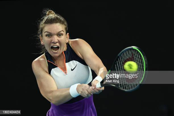 Simona Halep of Romania plays a backhand in her Women's Singles Quarterfinals match against Serena Williams of the United States during day nine of...