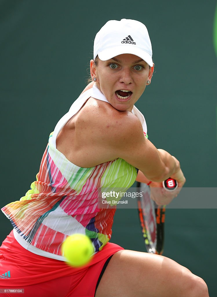 Simona Halep of Romania plays a forehand against Heather Watson of Great Britain in their fourth round match during the Miami Open Presented by Itau at Crandon Park Tennis Center on March 28, 2016 in Key Biscayne, Florida.