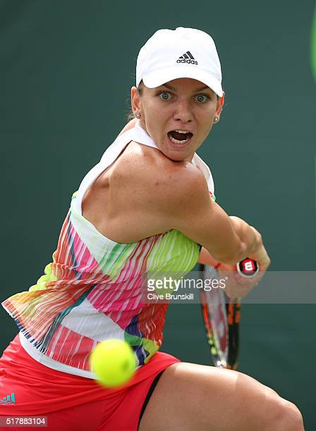 Simona Halep of Romania plays a forehand against Heather Watson of Great Britain in their fourth round match during the Miami Open Presented by Itau...