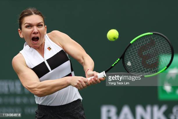 Simona Halep of Romania plays a forehand against Kateryna Kozlova of Ukraine during their women's singles third round match on Day 7 of the BNP...