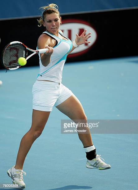 Simona Halep of Romania plays a forehand during her junior girls semifinal match against Jessica Moore of Australia on day twelve of the Australian...