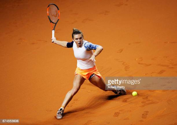 Simona Halep of Romania plays a forehand during her match against Anastasija Sevastova of Latvia during the Porsche Tennis Grand Prix at Porsche...